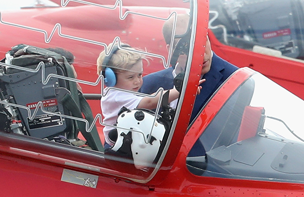 Prince William, Duke of Cambridge with Prince George in the cockpit of a Red Arrow during a visit to the Royal International Air Tattoo at RAF Fairford on July 8, 2016 in Fairford, England.