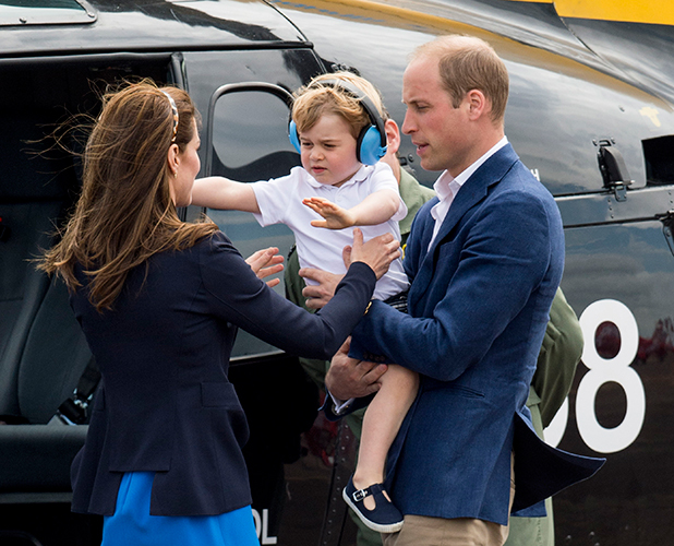 JULY 08: Prince William, Duke of Cambridge and Catherine, Duchess of Cambridge with Prince George of Cambridge during a visit to The Royal International Air Tattoo at RAF Fairford on July 8, 2016 in Fairford, England.
