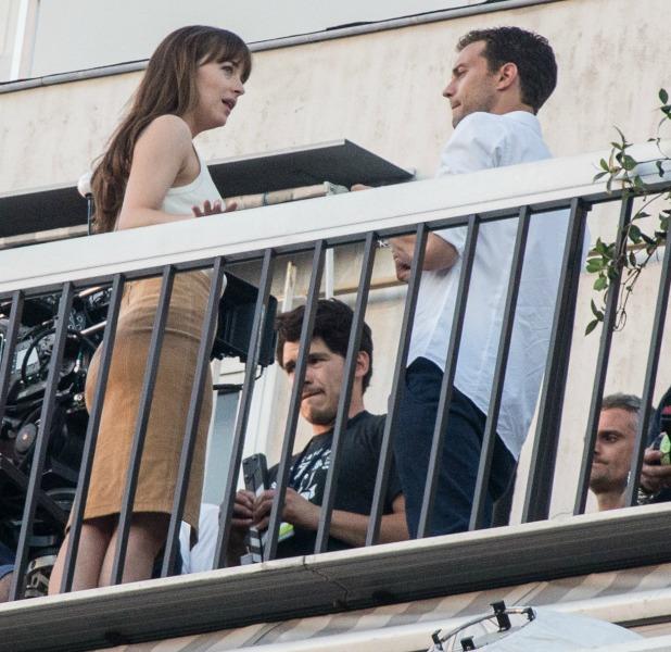 Jamie Dornan and Dakota Johnson kiss by the Eiffel Tower while filming 'Fifty Shades Darker' in Paris