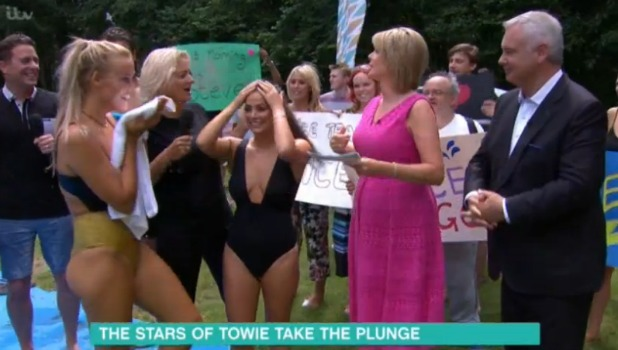 TOWIE stars Courtney Green, Chloe Meadows, Mike Hassini and Chris Clark race each over on giant inflatable water slide. This Morning, 20 July 2016 London