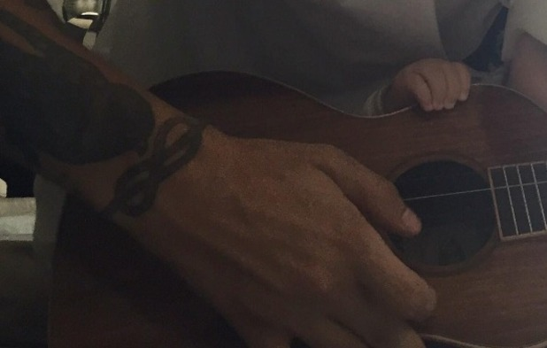 Louis Tomlinson shares new photo of son Freddie clutching his guitar 2 August 2016