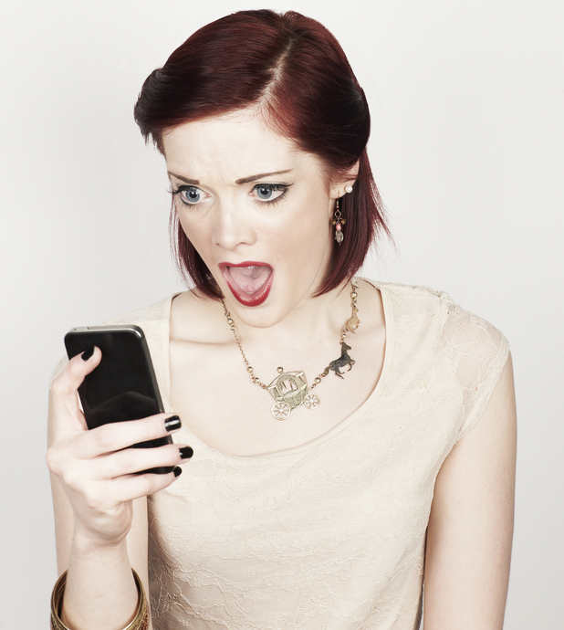 Woman realising she has just sent a text to the wrong person Stock image