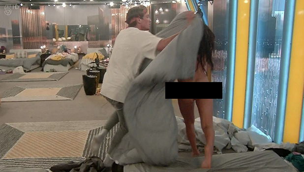 Lewis Bloor covers Marnies naked body with a duvet on 'Celebrity Big Brother: Live'. Broadcast on Channel 5HD