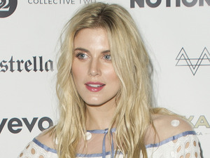 Exact match! Former Made In Chelsea star Ashley James serves retro vibes in laser-cut dress