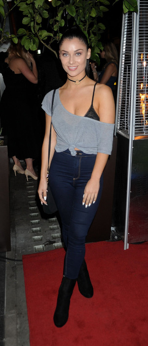Love Island's Cally Jane Beech flashes her bra at the QP Salon launch party in London, 6th September