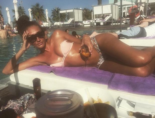 Megan McKenna sunbathes in Spain