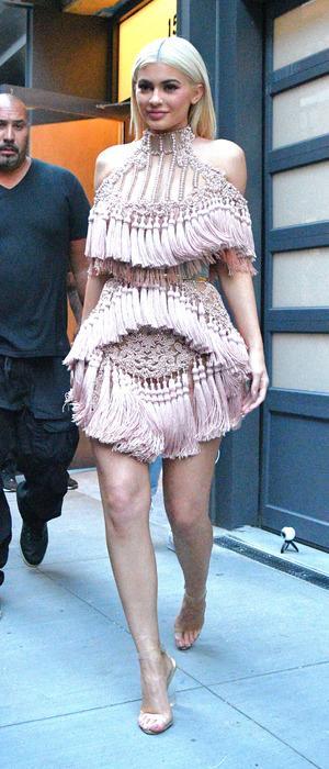 Kylie Jenner wearing pink tiered tassel dress in New York, 12 September 2016