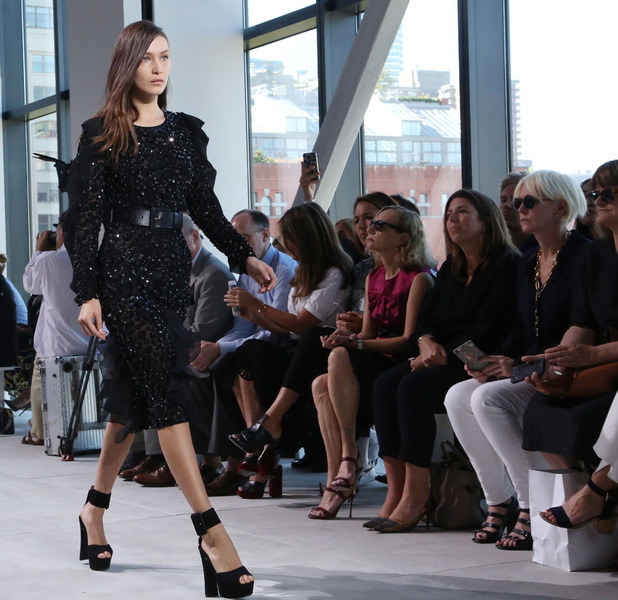 Bella Hadid walks the Michael Kors catwalk at New York Fashion Week before taking a tumble, 14 September 2016