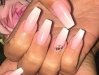 TOWIE's Megan McKenna shows off her bling-tastic nails before flying to Marbella