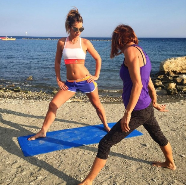 Vogue Williams practices yoga on holiday