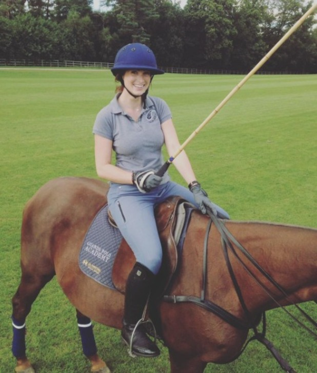 Luisa Zissman poses on her horse after playing polo