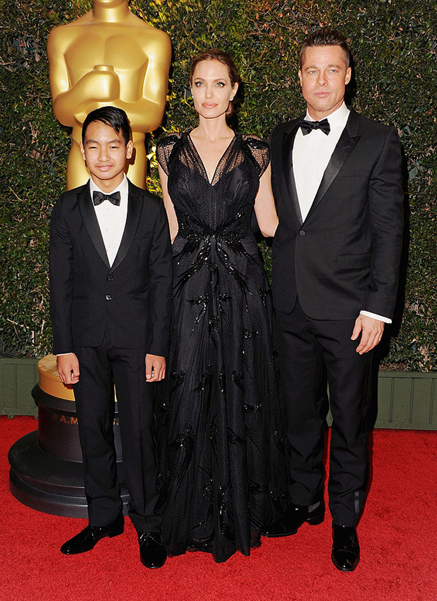 r Brad Pitt, actress Angelina Jolie and son Maddox Jolie-Pitt arrive at The Board Of Governors Of The Academy Of Motion Picture Arts And Sciences' Governor Awards at Dolby Theatre on November 16, 2013 in Hollywood, California. (Photo by Jon Kopaloff/FilmMagic)