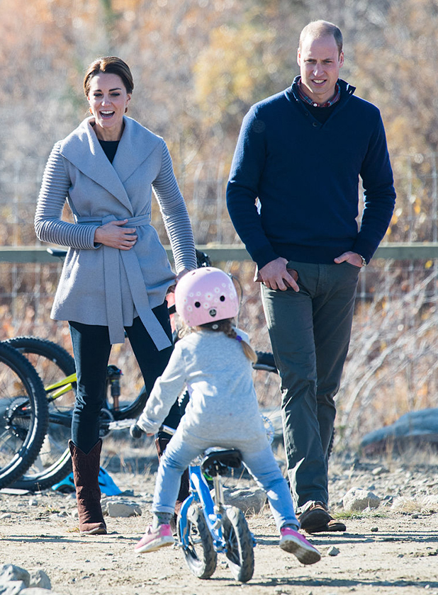 Catherine, Duchess of Cambridge and Prince William, Duke of Cambridge watch a young child on a mountain bike as they visit Montana mountain in Carcross on September 28, 2016 in Whitehorse, Canada. (Photo by Samir Hussein/WireImage)