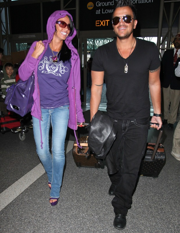 Katie Price and Peter Andre arriving at LAX en route to the the UK Los Angeles, California - 12.04.09