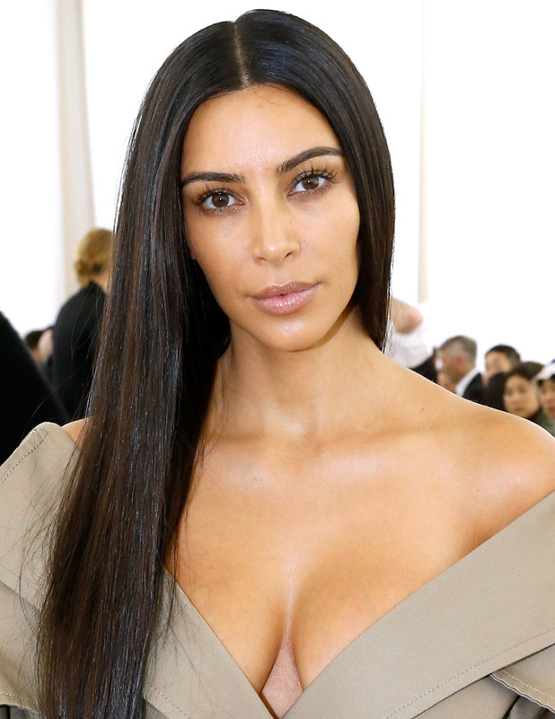 Kim Kardashian wears no make-up on the Givenchy front row at Paris Fashion Week, 3 October 2016
