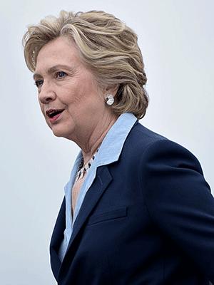 Democratic presidential nominee Hillary Clinton arrives at Toledo Express Airport October 3, 2016 in Swanton, Ohio. / AFP / Brendan Smialowski (Photo credit should read BRENDAN SMIALOWSKI/AFP/Getty Images)