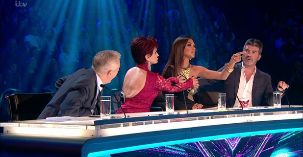 Judges during the live shows of 'The X Factor'. Broadcast on ITV1HD Sharon Osbourne and Nicole Scherzinger