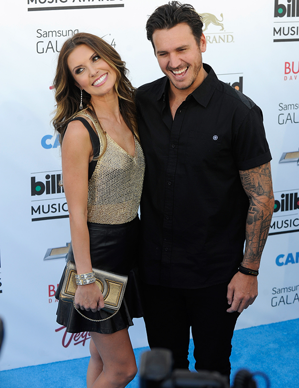 Audrina Patridge (L) and BMX rider Corey Bohan arrive at the 2013 Billboard Music Awards at the MGM Grand Garden Arena on May 19, 2013 in Las Vegas, Nevada. (Photo by David Becker/Getty Images)