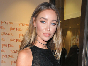 Former TOWIE star Lauren Pope oozes fierce in patent trousers