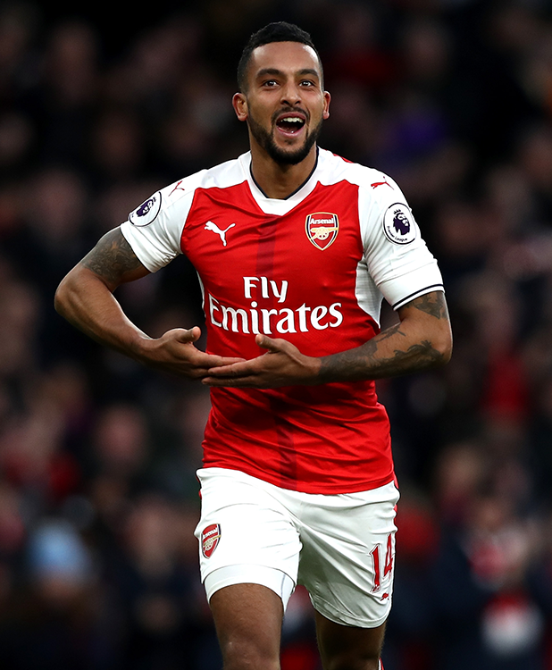 Theo Walcott of Arsenal celebrates scoring his sides second goal during the Premier League match between Arsenal and AFC Bournemouth at Emirates Stadium on November 27, 2016 in London, England. (Photo by Clive Rose/Getty Images)