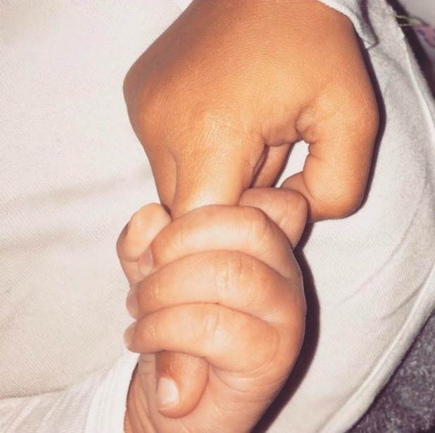 Kim Kardashian shows first glimpse of baby Saint, 3 January 2016.